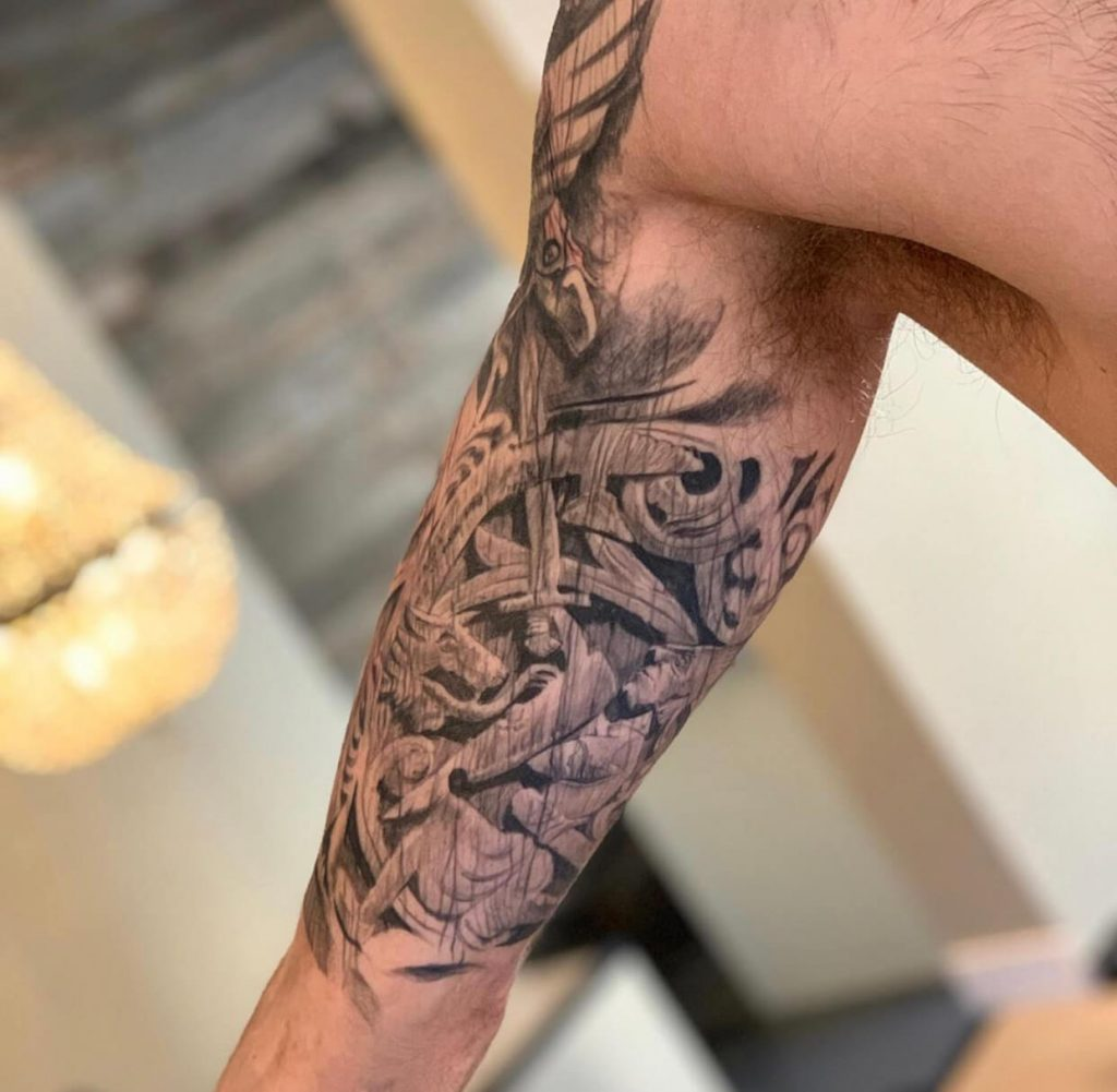 Norse wood carving tattoo by Kaireetattoo