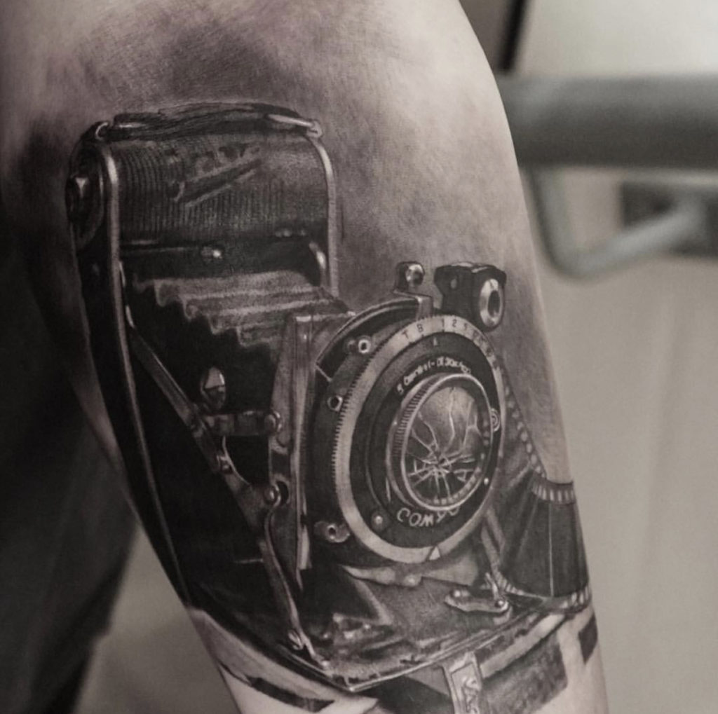 realistic vintage camera tattoo